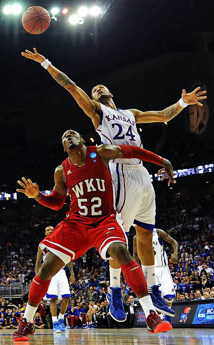 Travis Releford grabs a rebound against Western Kentucky. Releford had three rebounds and 11 points in the game.