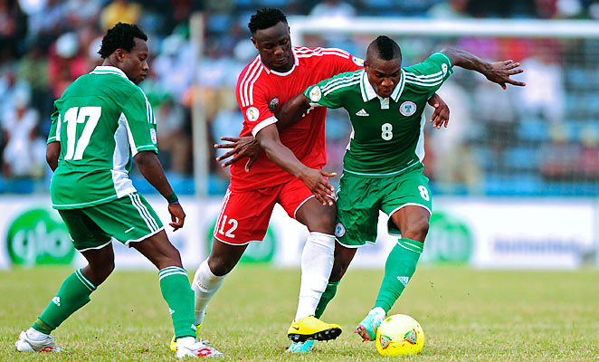 Kenya's Victor Wanyama, center, challenges Nigeria's Brown Ideye, right, during their World Cup qualifying soccer match in Nigeria.