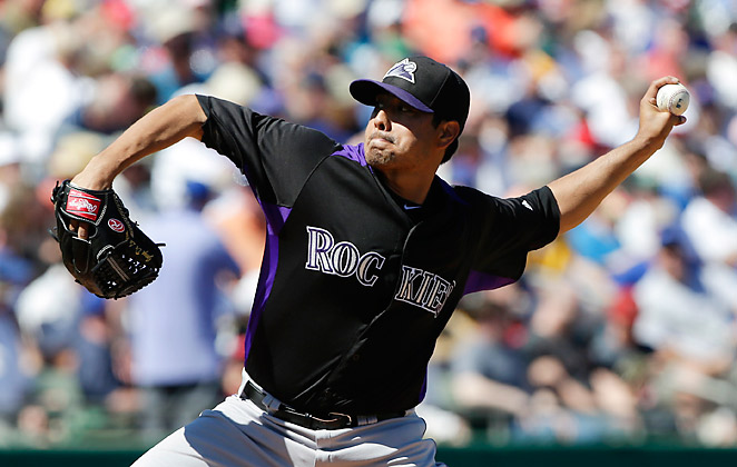 Jorge De La Rosa pitches in a spring training game against the Chicago Cubs on March 13.