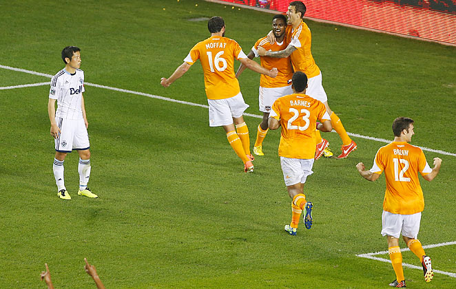 Dynamo defender Warren Creavalle celebrates his game-winning goal against the Vancouver Whitecaps.