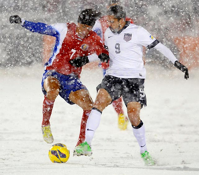 "Costa Rica midfielder Cristian Bolanos and United States forward Herculez Gomez fight for the ball during the second half of the ""SnowClasico"" in Commerce City, Colo., which the U.S. won 1-0."