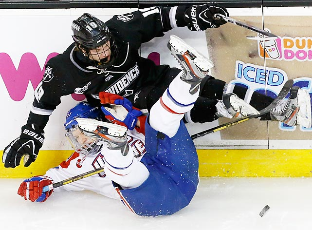 Providence's Derek Army (19) falls on UMass-Lowell's Dmitry Sinitsyn (21) while battling for the puck in the first period of an NCAA Hockey East semifinal.