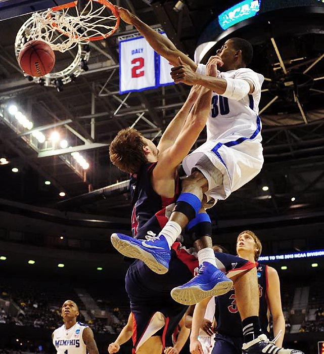Memphis's D.J. Stephens throws a dunk down over St. Mary's guard Matthew Dellavedova during the Tigers' 54-52 win over the Gaels.