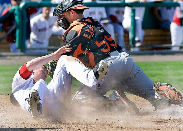 Boston Red Sox's Jeremy Hazelbaker slides safely into home to score on a single by Jonathan Diaz during a spring training game against the Baltimore Orioles.