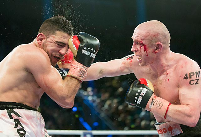 Karim Achour of France, left, and Lukas Konecny of Czech Republic fight for the WBO Europe middleweight title in Magdeburg, Germany. Knoecny won by unanimous decision.