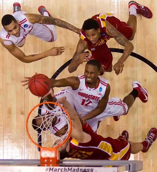 Ohio State's Sam Thompson goes up for a layup between two Iowa State players. The Buckeyes survived on a last-second three-point basket from Aaron Craft to advance to the Sweet 16.