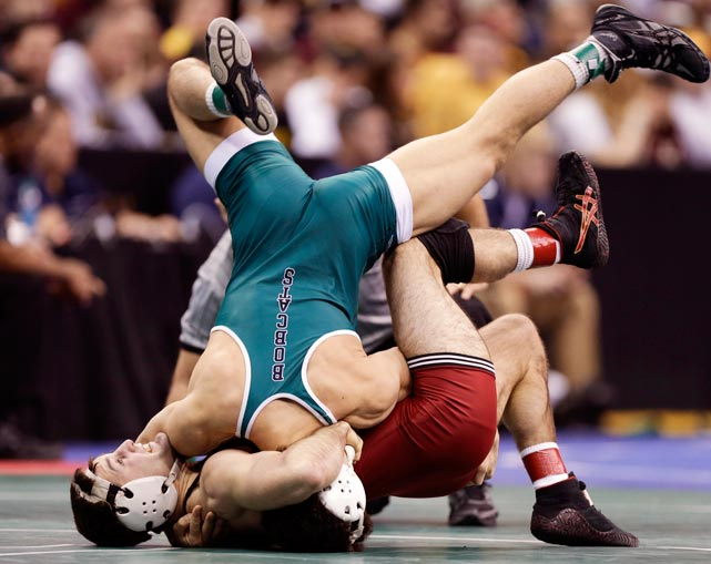 Harvard's Walter Peppelman is pinned by Ohio's Spartak Chino, top, during their 157-pound match at the NCAA Division I wrestling championships.
