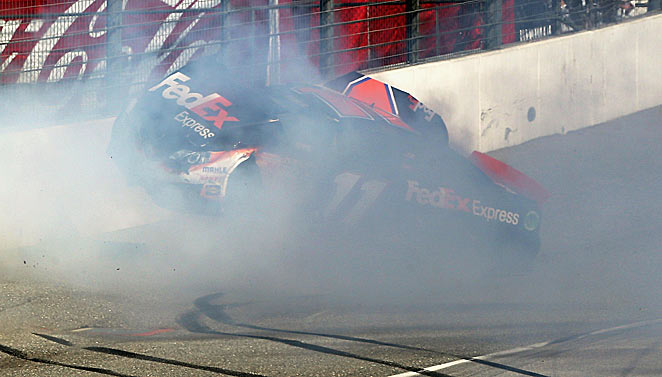 Denny Hamlin hit the wall at Auto Club Speedway head-on after being spun out by Joey Logano.