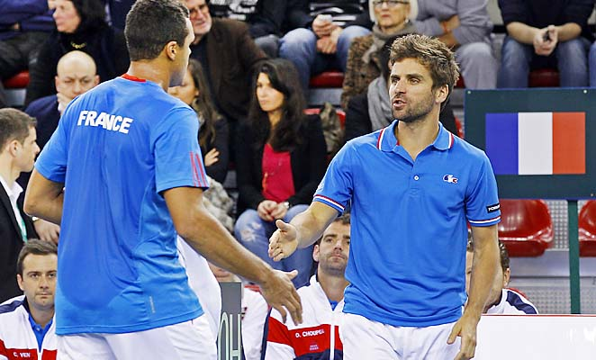 Jo-Wilfried Tsonga and Arnaud Clement converse during France's first-round win over israel.