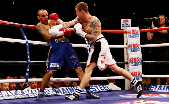 Ricky Burns' last fight ended in a fourth-round TKO victory over Kevin Mitchell (left) in Sept. 2012.