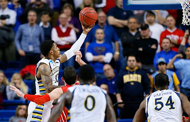 <bold>Vander Blue's left-handed layup with a second left gave Marquette a 59-58 win over Davidson in the first round and threatened to make him a household name. Two days later he scored 19 second-half points (29 overall) in a 74-72 comeback win over Butler. He's trying to lead Marquette to its first Final Four since Dwyane Wade pulled off the feat in 2003.</bold>