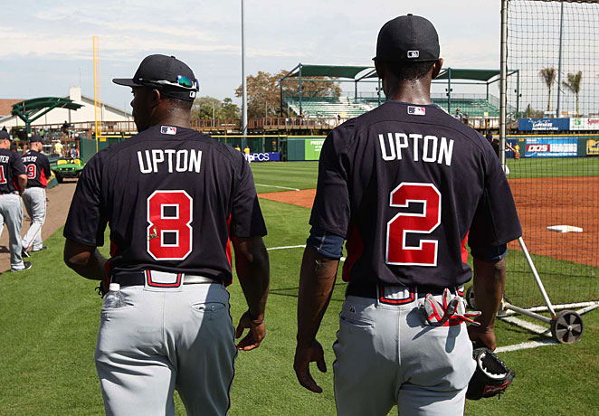 Justin Upton (left) and his older brother B.J. should help get the Braves back to the postseason.