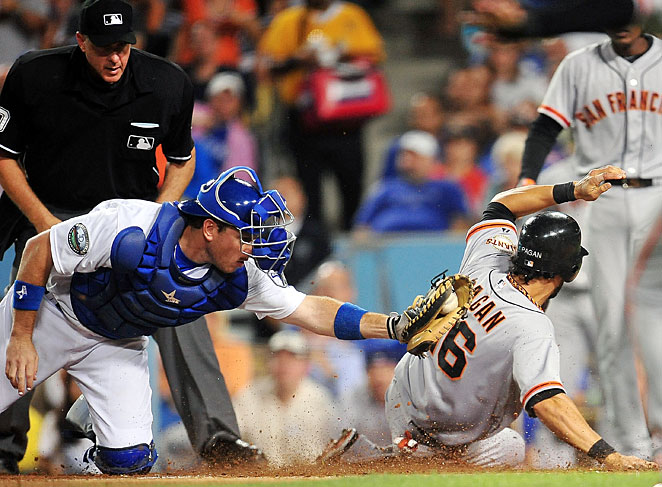 A.J. Ellis and the Dodgers are trying to catch Angel Pagan and the Giants in the NL West this season.