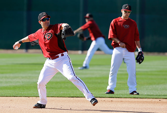 Willie Bloomquist throws during a spring training baseball workout with the Diamondbacks.