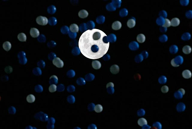 If only it were June with a spoon clearly visible, this moon with balloons would have been an unearthly inspiration for poets and lyricists everywhere. As it was, this spectacle honored Chile's soccer team, which deflated Uruguay, 2-0, in their Cup qualifying match in Santiago.