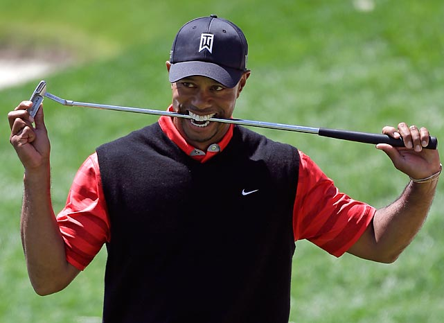 "Club sandwich: Tiger Woods chowed down after blowing a putt on the 18th green during the final round of the Arnold Palmer Invitational in Orlando, Fla. In other news, the inimitable <italics>New York Post</italics> reported, ""Tiger Woods and Nike opened themselves up to an industrial-sized can of social media whoop-ass after the company released an online ad displaying a picture of the golfer with a quote attributed to him: 'Winning takes care of everything.'"" Indeed. Tiger's win restored him to his throne as the world's No. 1 professional divot-digger."