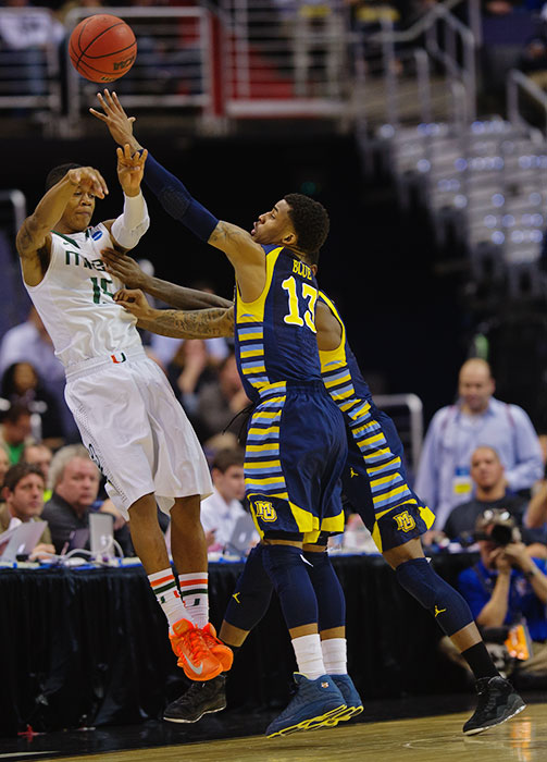 <bold>Vander Blue pressures Dion Brown as Marquette moved within a win of reaching the Final Four for the first time since Dwyane Wade took them there a decade ago.</bold> <bold>Defeated Davidson 59-58</bold> <bold>Defeated Butler 74-72</bold> <bold>Defeated Miami 71-61</bold>