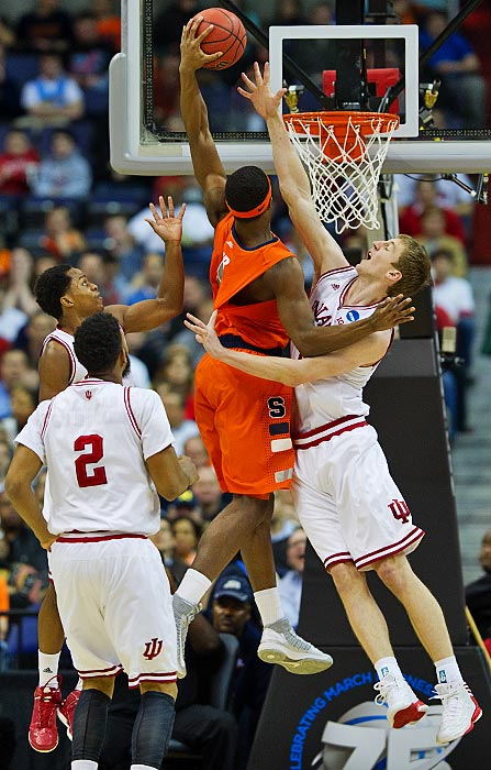 <bold>C.J. Fair tries to dunk over Indiana's Cody Zeller. Syracuse held Indiana to its lowest point total of the season, forced 19 turnovers, compiled 10 blocks and held the normally efficient Hoosiers to 33 percent shooting.</bold> <bold>Defeated Montana 81-34</bold> <bold>Defeated Cal 66-60</bold> <bold>Defeated Indiana 61-50</bold>