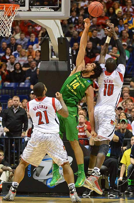 <bold>Arsalan Kazemi (14) of Oregon battling Gorgui Dieng (10) of Louisville for rebound. </bold> <bold>Defeated North Carolina A&T 79-48</bold> <bold>Defeated Colorado St. 82-56</bold> <bold>Defeated Oregon 77-69</bold>