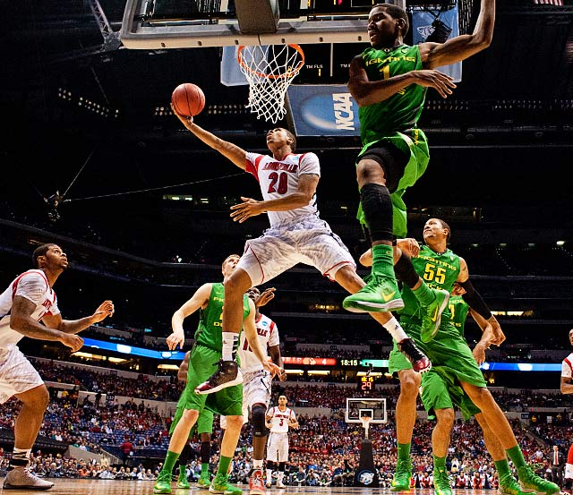 <bold>Wayne Blackshear (20) of Louisville slashes inside for a basket against the Oregon Ducks. Louisville withstood a late rally from Oregon to advance to the Elite Eight. </bold> <bold>Defeated North Carolina A&T 79-48</bold> <bold>Defeated Colorado St. 82-56</bold> <bold>Defeated Oregon 77-69</bold>