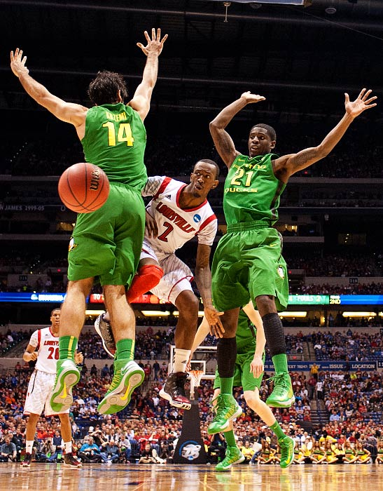 <bold>Russ Smith (2) of Louisville makes pass inside. Smith led Louisville with 31 points in the win over Oregon. </bold> <bold>Defeated North Carolina A&T 79-48</bold> <bold>Defeated Colorado St. 82-56</bold> <bold>Defeated Oregon 77-69</bold>