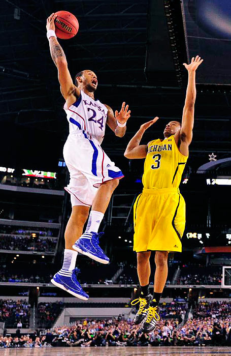 <bold>Kansas guard Travis Releford (24) goes in for a layup against Michigan in the Sweet Sixteen.</bold> <bold>Defeated S. Dakota State 71-56</bold> <bold>Defeated VCU 78-53</bold> <bold>Defeated Kansas 87-85</bold>