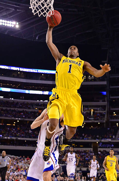 <bold>Michigan's Glenn Robinson III goes in for a dunk against Kansas on Friday night. Robinson II had 13 points and eight rebounds in the game. </bold> <bold>Defeated S. Dakota State 71-56</bold> <bold>Defeated VCU 78-53</bold> <bold>Defeated Kansas 87-85</bold>