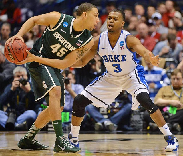 <bold>Duke guard Tyler Thornton guards Michigan State's Denzel Valentine. Thornton had three points, two steals, and two assists in the Blue Devils' win. </bold> <bold>Defeated Albany 73-61</bold> <bold>Defeated Creighton 66-50</bold> <bold>Defeated Michigan St. 71-61</bold>