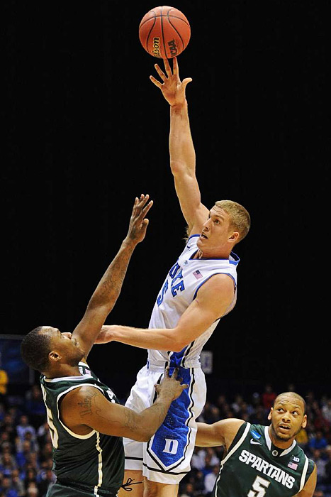 <bold>Mason Plumlee (5) of Duke attempts a hook shot against Michigan State on Friday night. </bold> <bold>Defeated Albany 73-61</bold> <bold>Defeated Creighton 66-50</bold> <bold>Defeated Michigan St. 71-61</bold>