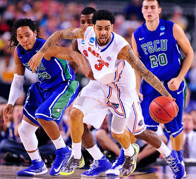 <bold>Mike Rosario (3) of Florida dribbles past FGCU defender in Florida's win on Friday.</bold> <bold>Defeated Northwestern St. 79-47</bold> <bold>Defeated Minnesota 78-64</bold> <bold>Defeated FGCU 62-50</bold>