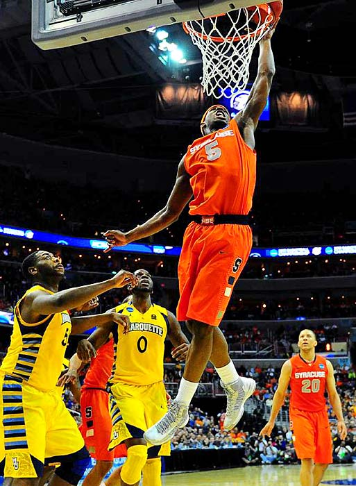 <bold>Syracuse's C.J. Fair throws down a dunk against Marquette in their regional final. </bold> <bold>Defeated Montana 81-34</bold> <bold>Defeated California 66-60</bold> <bold>Defeated Indiana 61-50</bold> <bold>Defeated Marquette 55-39</bold> <bold>Next: vs. Michigan</bold>