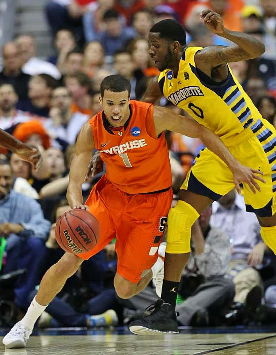 <bold>Syracuse guard Michael Carter-Williams dribbles under pressure in the Orange's game against Marquette. </bold> <bold>Defeated Montana 81-34</bold> <bold>Defeated California 66-60</bold> <bold>Defeated Indiana 61-50</bold> <bold>Defeated Marquette 55-39</bold> <bold>Next: vs. Michigan</bold>