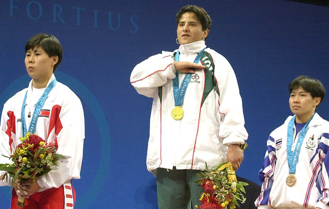 Weightlifter Soraya Jimenez, center, died of a heart attack at 35. She was the first female gold medalist in Mexican history.