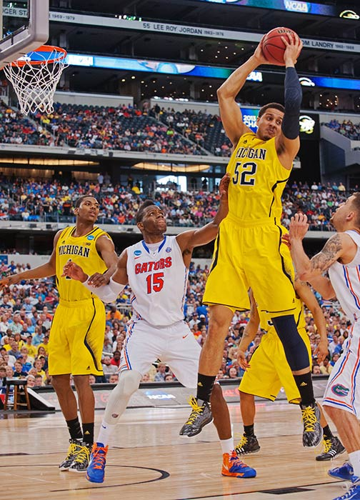 <bold>Jordan Morgan and the Wolverines jumped to a 13-0 lead against Florida and maintained a double-digit advantage throughout the game.</bold> <bold>Defeated S. Dakota State 71-56</bold> <bold>Defeated VCU 78-53</bold> <bold>Defeated Kansas 87-85</bold> <bold>Defeated Florida 79-59</bold> <bold>Next: vs. Syracuse</bold>