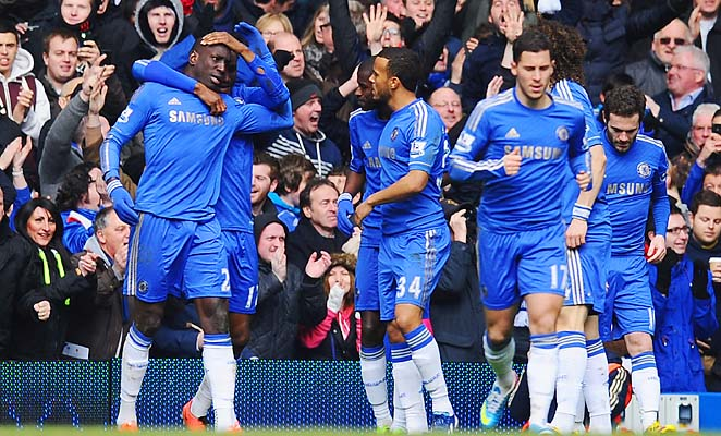 Chelsea players celebrate the goal scored by Demba Ba (left) in the 49th minute.
