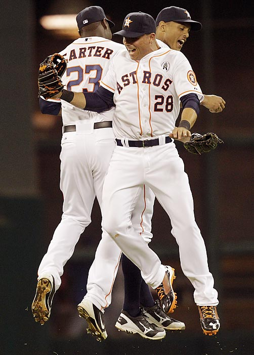 Chris Carter (23), Rick Ankiel (28) and Justin Maxwell (44) of the Houston Astros celebrate after the final out against the Texas Rangers.