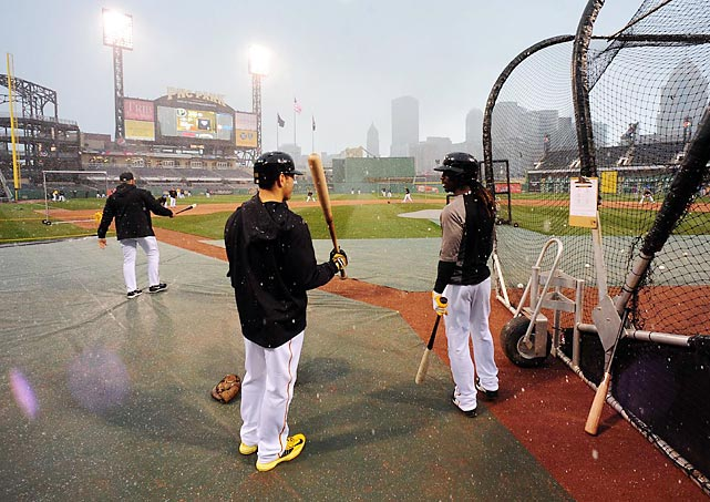 Andrew McCutchen and Russell Martin take batting practice in the snow before the Pirates' opener against the Chicago Cubs in Pittsburgh.