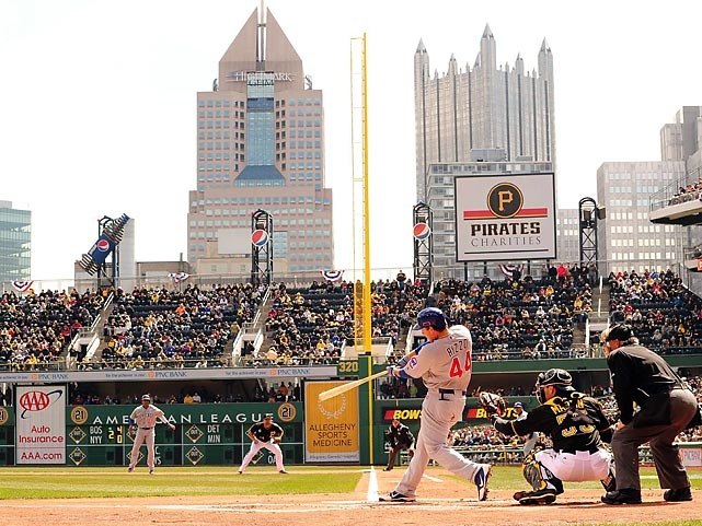 The Cubs' Anthony Rizzo smashes a home run in his first at-bat of the season during the opener against the Pittsburgh Pirates.