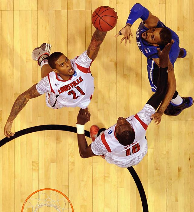 Cardinals forward Chane Behanan pulls down one of his eight rebounds as Louisville bested Duke in Indianapolis to claim a spot in the Final Four.