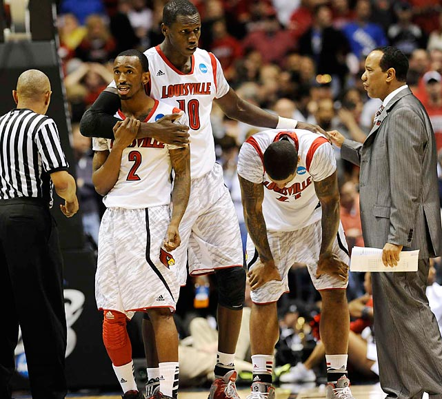 Fellow Cardinals Russ Smith (2), Gorgui Dieng (10) and Chane Behanan (21) were distraught after Kevin Ware's grisly injury in the first half of their Elite Eight showdown against Duke.