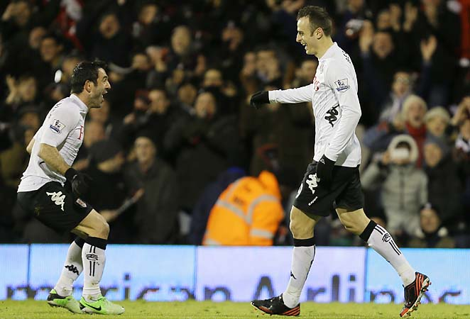 Fulham's Dimitar Berbatov (right) celebrates with teammate Giorgos Karagounis after scoring his second goal.