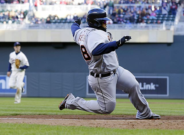 Prince Fielder races home to score on a wild pitch by Minnesota's Josh Roenicke in the eighth inning of Detroit's 4-2 victory.