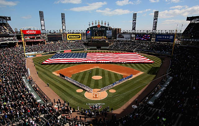 Members of the Chicago White Sox and the Kansas City Royals stand during the National Anthem before the Opening Day game at U.S. Cellular Field in Chicago.
