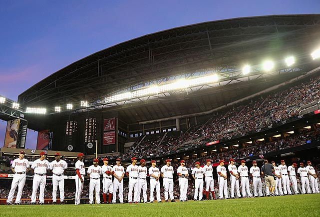 The Arizona Diamondbacks line up for introductions before the Opening Day game against the St. Louis Cardinals at Chase Field in Phoenix.