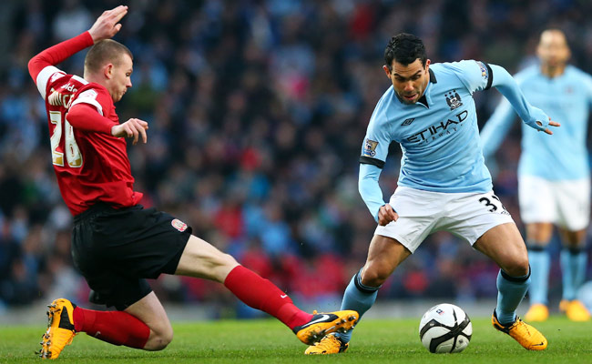 Carlos Tevez was arrested for driving without a license on March 7.