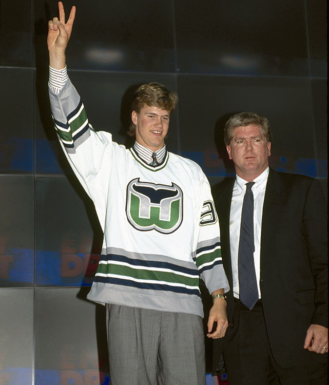 Chris Pronger, 19, was taken by the Hartford Whalers second overall at the 1993 NHL Draft in Quebec City. (GM Brian Burke, right, made two trades to land the pick; center Alexandre Daigle went first to the Ottawa Senators.) A punishing, mobile defender with scoring punch, the highly-touted Pronger starred for the OHL Peterborough Petes before jumping to the NHL immediately after the draft. As a rookie in 1993-94, he scored five goals and 31 points in 81 regular season games, and had much potential to fulfill.