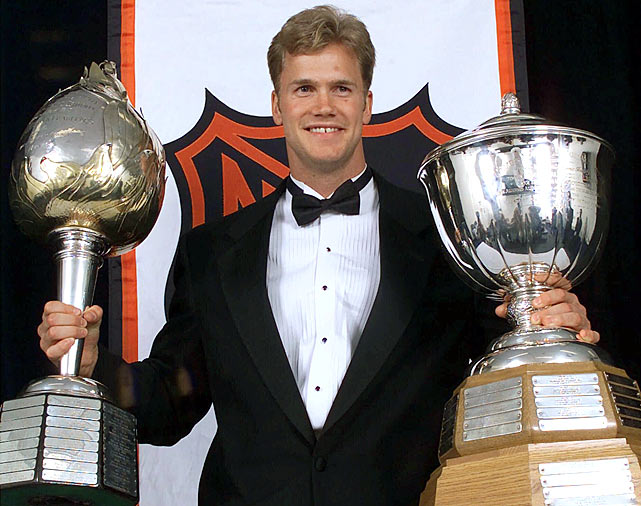 In June 2000, Pronger won the Norris Trophy (right) as the NHL's top defenseman and became the first blueliner since Bobby Orr to win the Hart Trophy (left) as league MVP. That season, he scored 62 points (14 goals, 48 assists), made his second All-Star Game appearance, and led the league in plus/minus (+52).