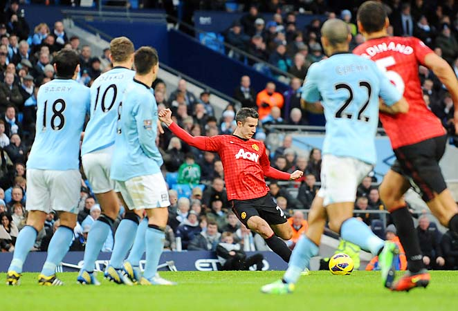 Robin van Persie scores the game-winning goal against Manchester City in December.