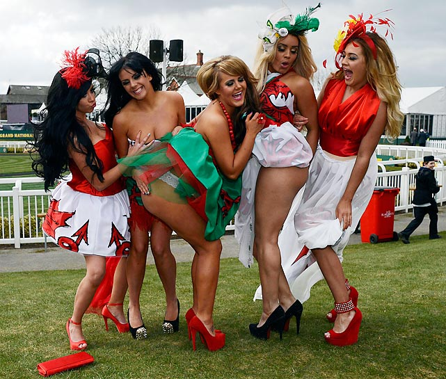 Racy fans is more like it as these fillies were feelin' frisky during the Grand National meeting at England's Aintree racecourse.