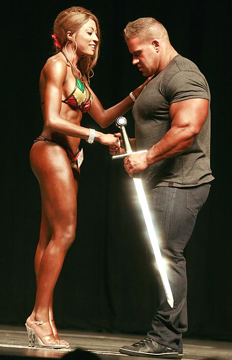 No, not the Chicago Bears quarterback, the four-time Mr Olympia presents the ceremonial cutlery to Mimi Macias, winner of the Overall Womens' Bikini competition at Palms Casino Resort in Las Vegas.